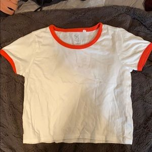 white crop top with orange outline